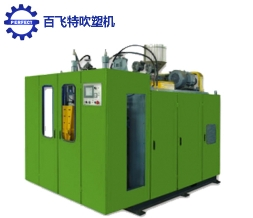 Two position blow molding machine